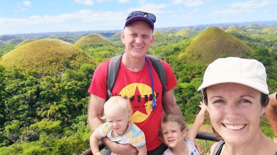 Worldschooling and slow travel adventures- Chocolate Hills, Philippines, Colin, Elly, Romy, Ayla