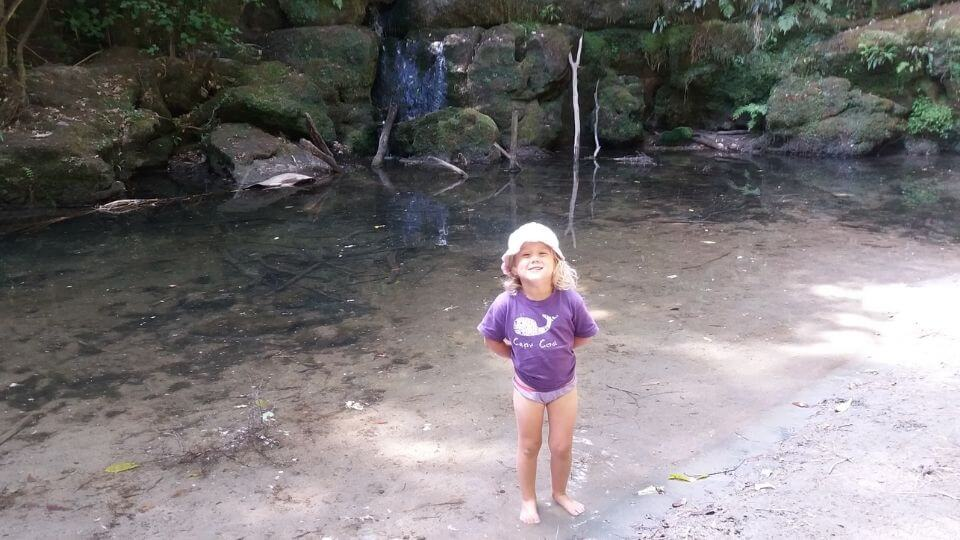 Things to do in Gisborne-Waihirere Domain waterfall walk-Ayla in the water