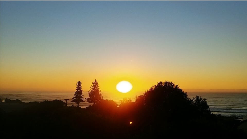 Things to do in Gisborne-watch the sunrise in the first city to see the sun-wainui beach view