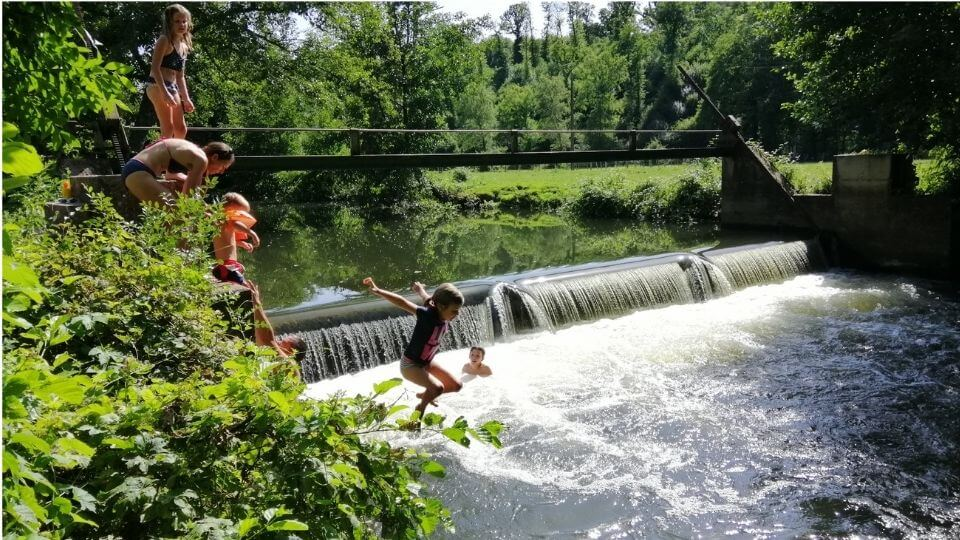 Things to do in Poitou Charentes-summer river swimming-Charroux-Ayla jumping in river