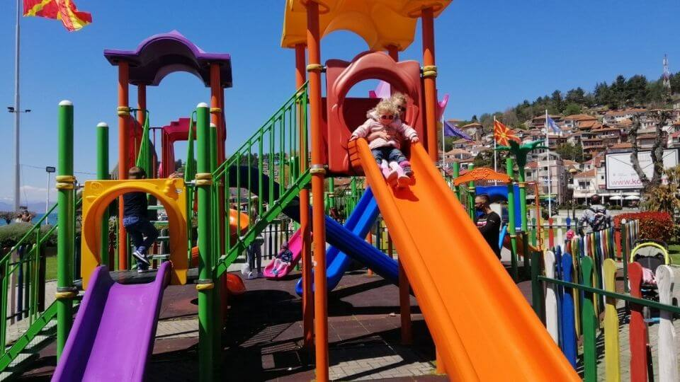 Things to do in Ohrid-Ohrid City Park and Spielplatx playground-Ayla and Romy at top of slide