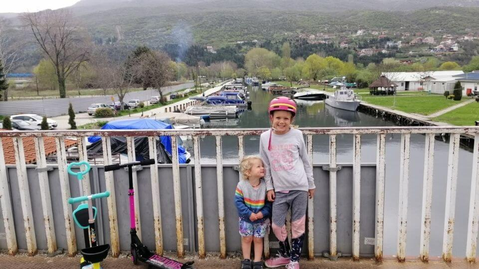 Things to do in Ohrid town-bridge before the skate park-lakefront Promenade-Romy and Ayla with scooters